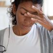 Woman experiences brain fog, a neurological symptom related to COVID-19.