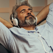 A man listens to calming music to ease anxiety, lower stress, and improve heart health.